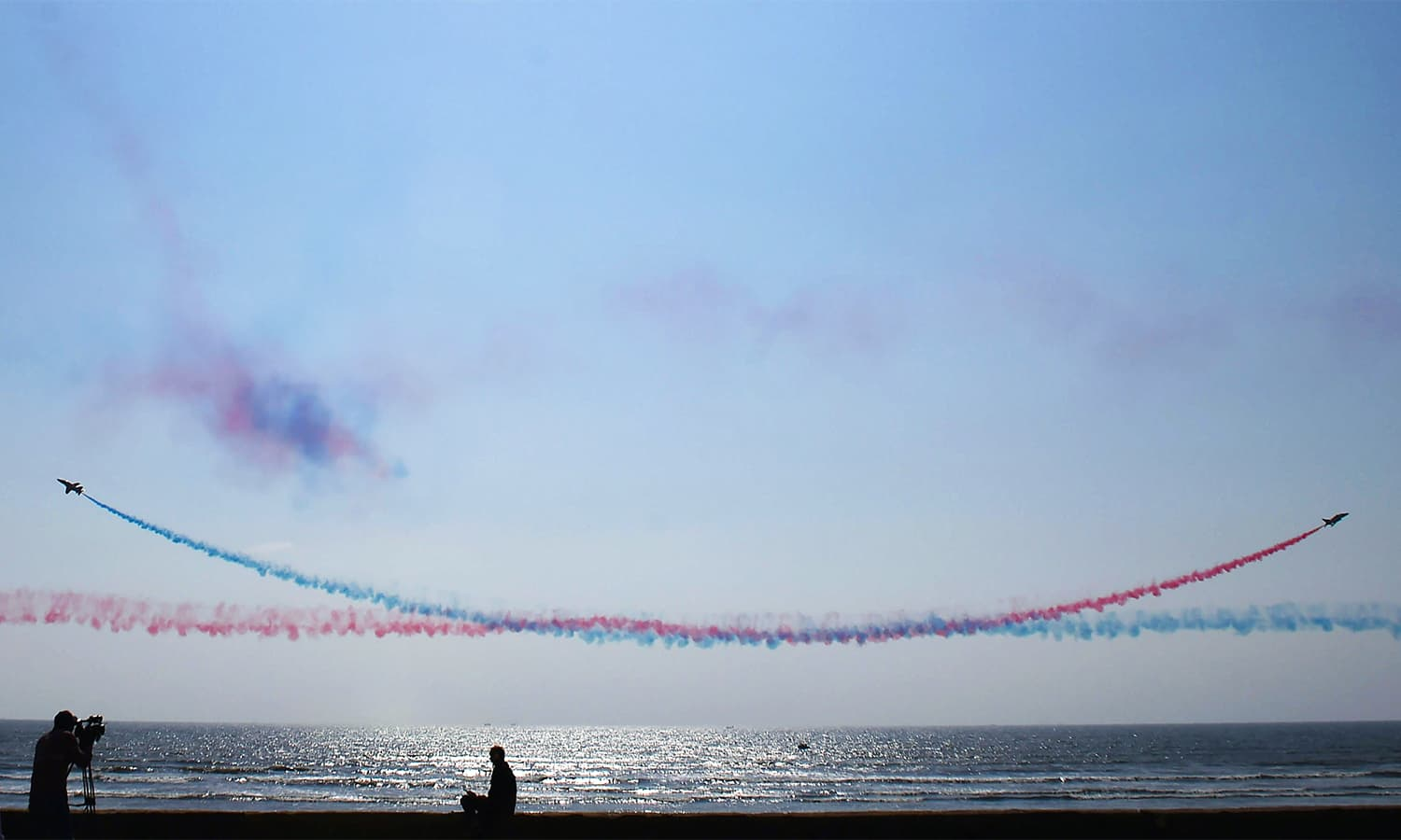 RAF's aerobatic team, the 'Red Arrows', performs aerial manoeuvres during an airshow at Sea View. — AFP