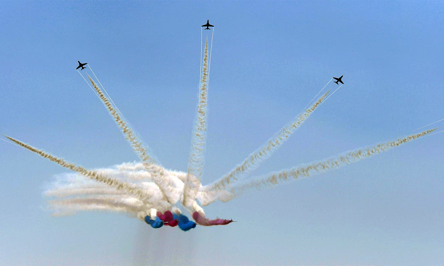 The RAF aerobatic team, the 'Red Arrows', performs aerial manoeuvres during an airshow at Sea View in Karachi. — AFP