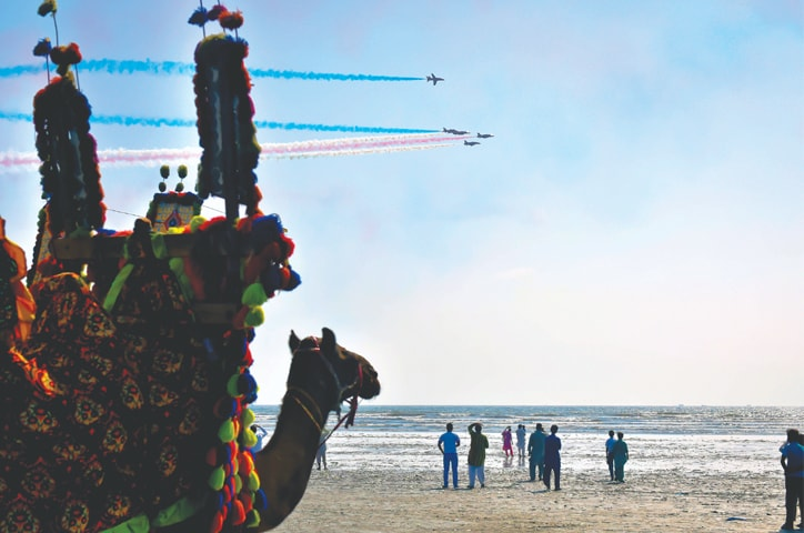 VISITORS are wowed by the soaring jets of the Red Arrows at Seaview beach on Thursday.—White Star