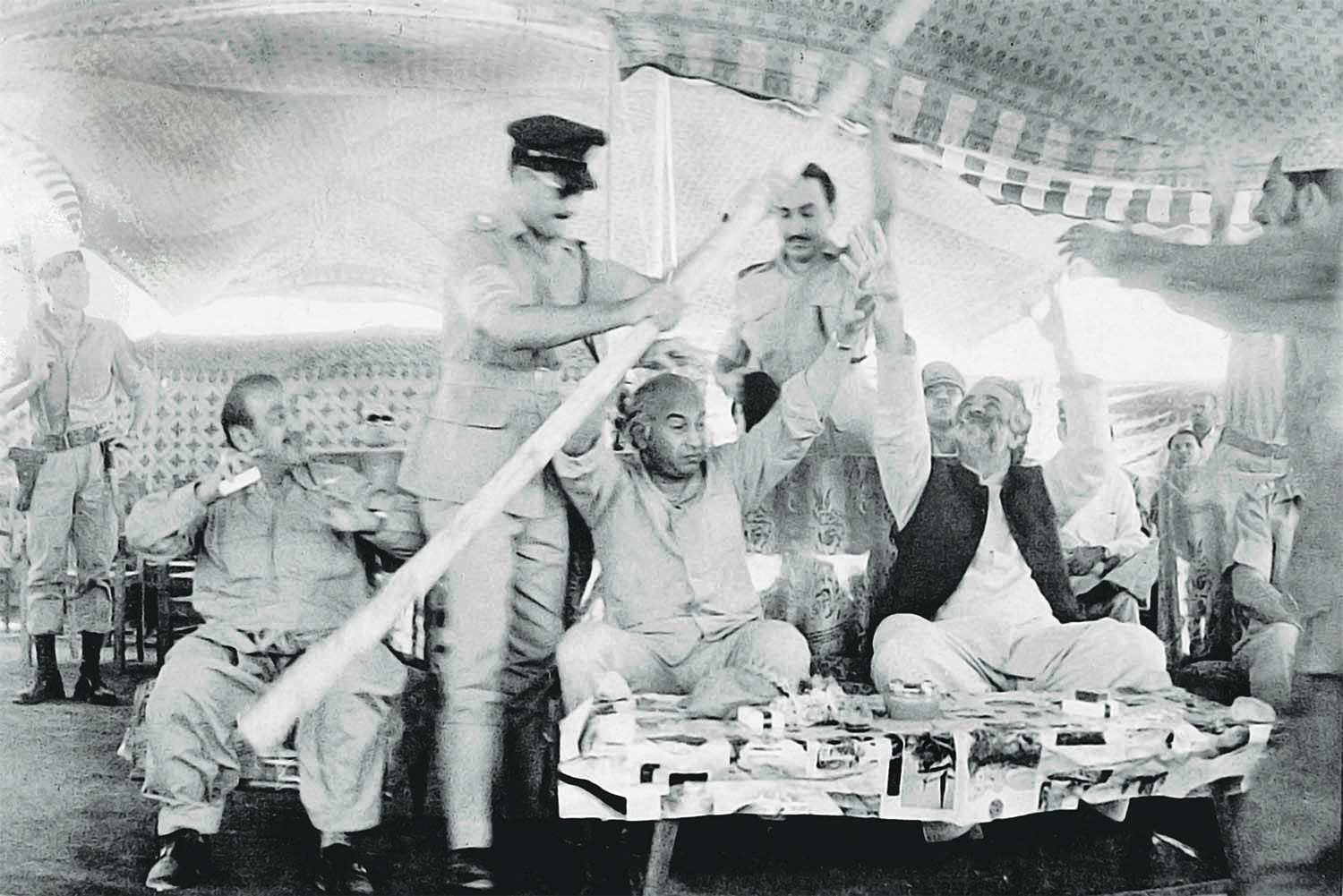 During a visit to Dera Bugti, Zulfikar Ali Bhutto and his host, Baluchistan Governor Nawab Akbar Bugti, had to stave off trouble when a tent collapsed during a public meeting. As subsequent events showed, political turbulence, however, could not be warded off that easily. | Photo: Dawn / White Star Archives