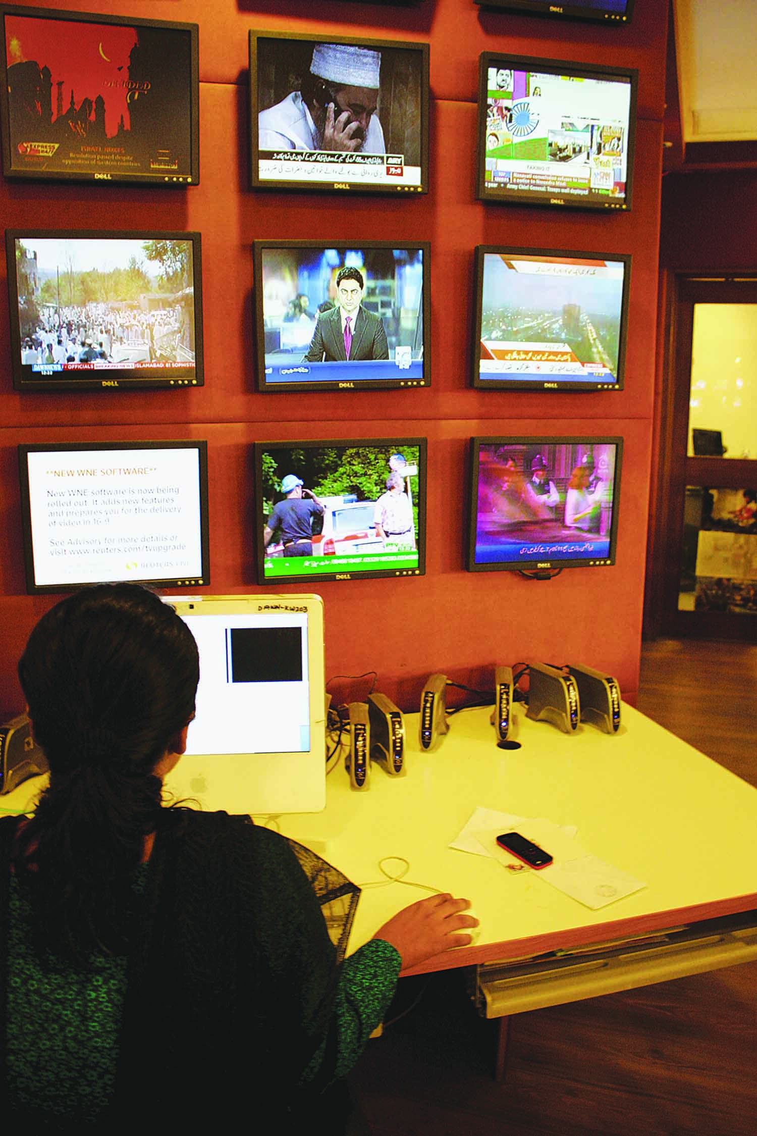 The last 15 years have seen a surge in the number of television channels and radio stations in the country. Seen here is a typical newsroom at a leading television channel, keeping track of multiple rivals to ensure being on the top of the competition.