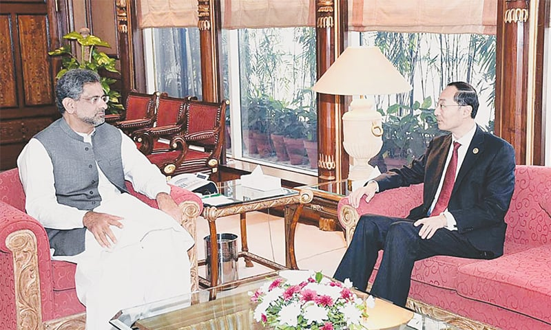 ISLAMABAD: Outgoing Chinese Ambassador Sun Weidong meets Prime Minister Shahid Khaqan Abbasi to bid farewell at the PM Office on Friday.—APP
