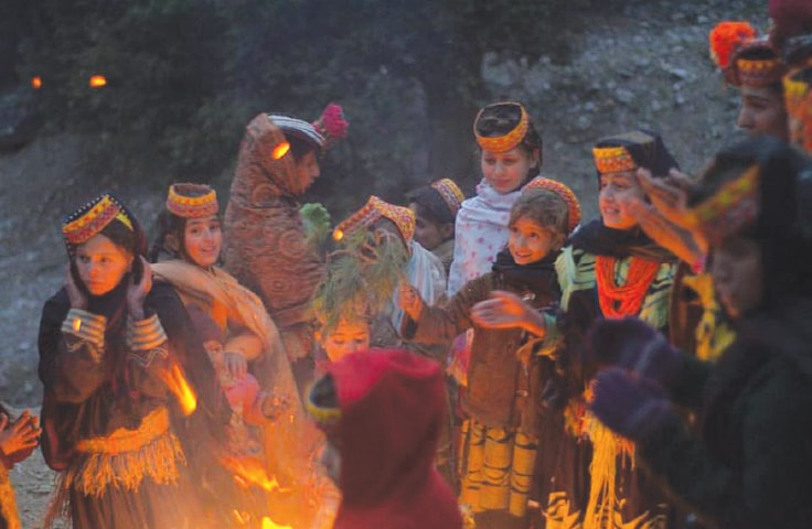 Children of the Kalash valley gather round the ceremonial fire marking the beginning of the Chowmos winter festival | Photos from the book