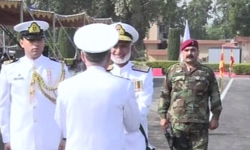 Admiral Zakaullah presents the traditional scroll to Admiral Abbasi.— DawnNews