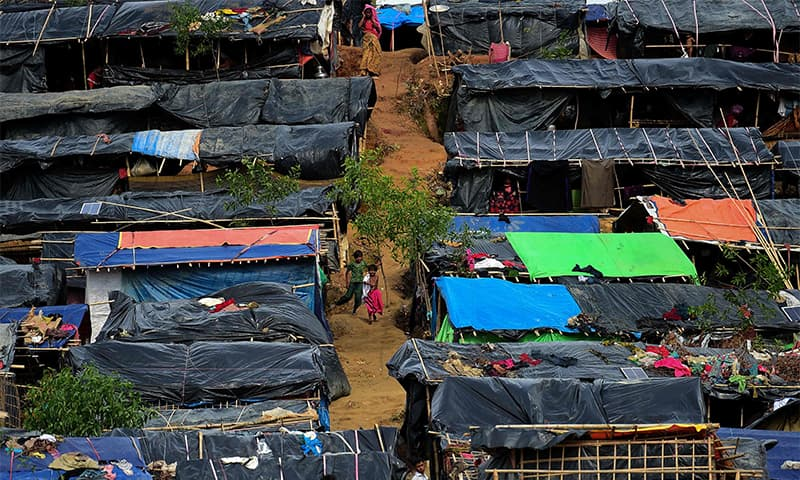 A Rohingya child run through a refugee camp of Thyangkhali in Teknaf. —AFP
