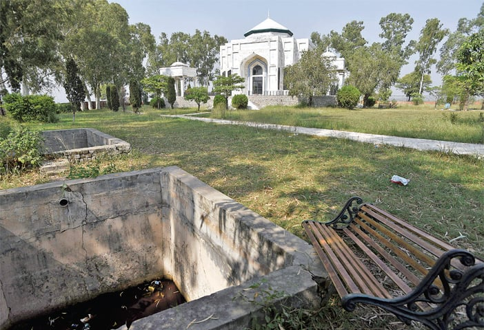 The gardens around the main building have been left unattended, and an old well and the water tanks are empty. — Photos by Tanveer Shahzad