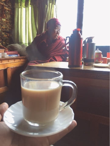 Having chai with the Lama of the Pangboche Monastry — Sherpas and mountaineers seek his blessing before their climbs