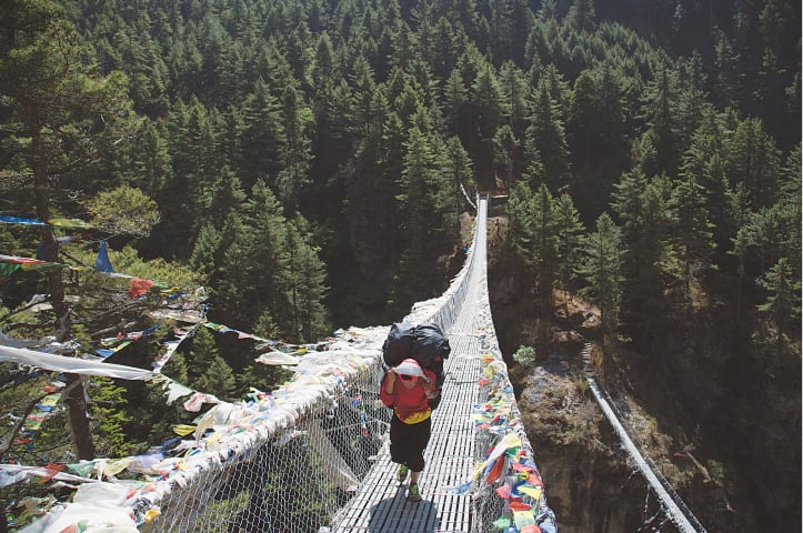 Trekkers have to cross several bridges like this one to go between mountains