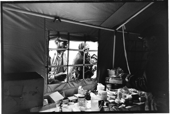 October, 2005: Medical supplies being dispensed from a tent pharmacy manned by police officers
