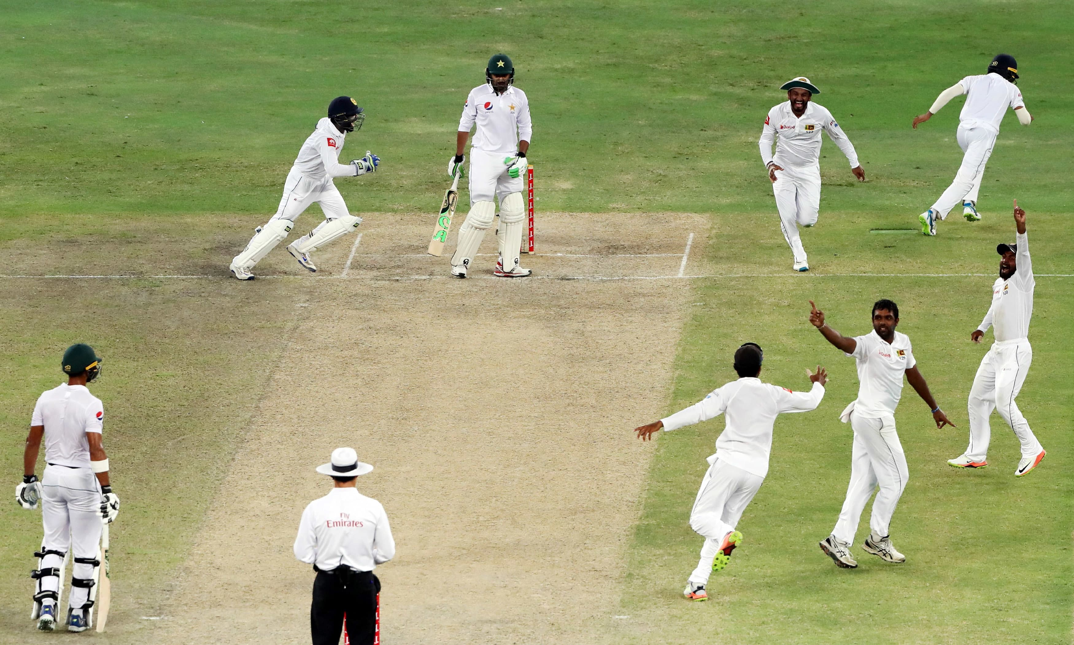 Sri Lanka's players celebrate the dismissal of Azhar Ali during the fourth day of the second Test. —AFP