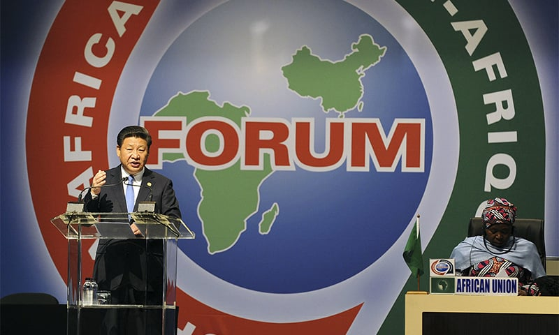 Chinese President Xi Jinping, left, delivers his speech during the opening ceremony of the Johannesburg Summit for the Forum on China-Africa Cooperation at the Sandton Convention Centre in Johannesburg in this Dec 4, 2015 photo.— AP/File