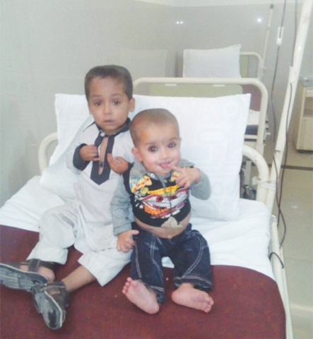 TWO brothers whose parents bring them to the Thalassaemia Centre on Quetta's Jinnah Road every two weeks for blood transfusion. They belong to Quetta's suburb town called Nawa Killi.—Photo by writer