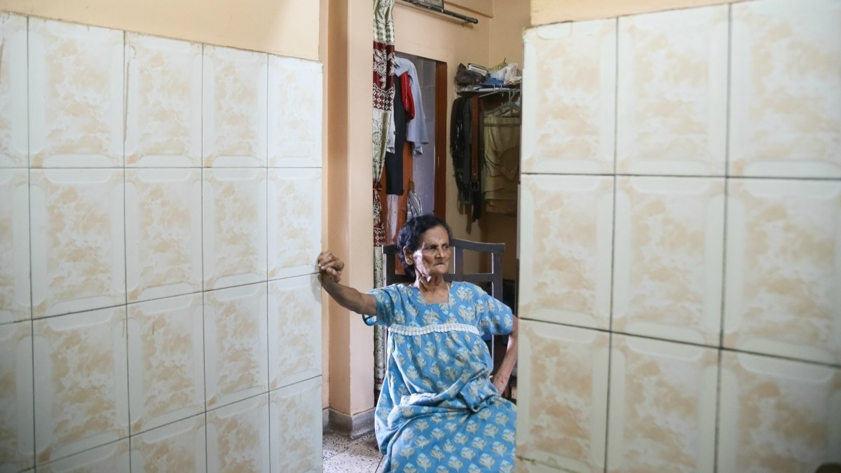 Rita Lobo takes a break to cool down from the heat of the kitchen — Photo by the author
