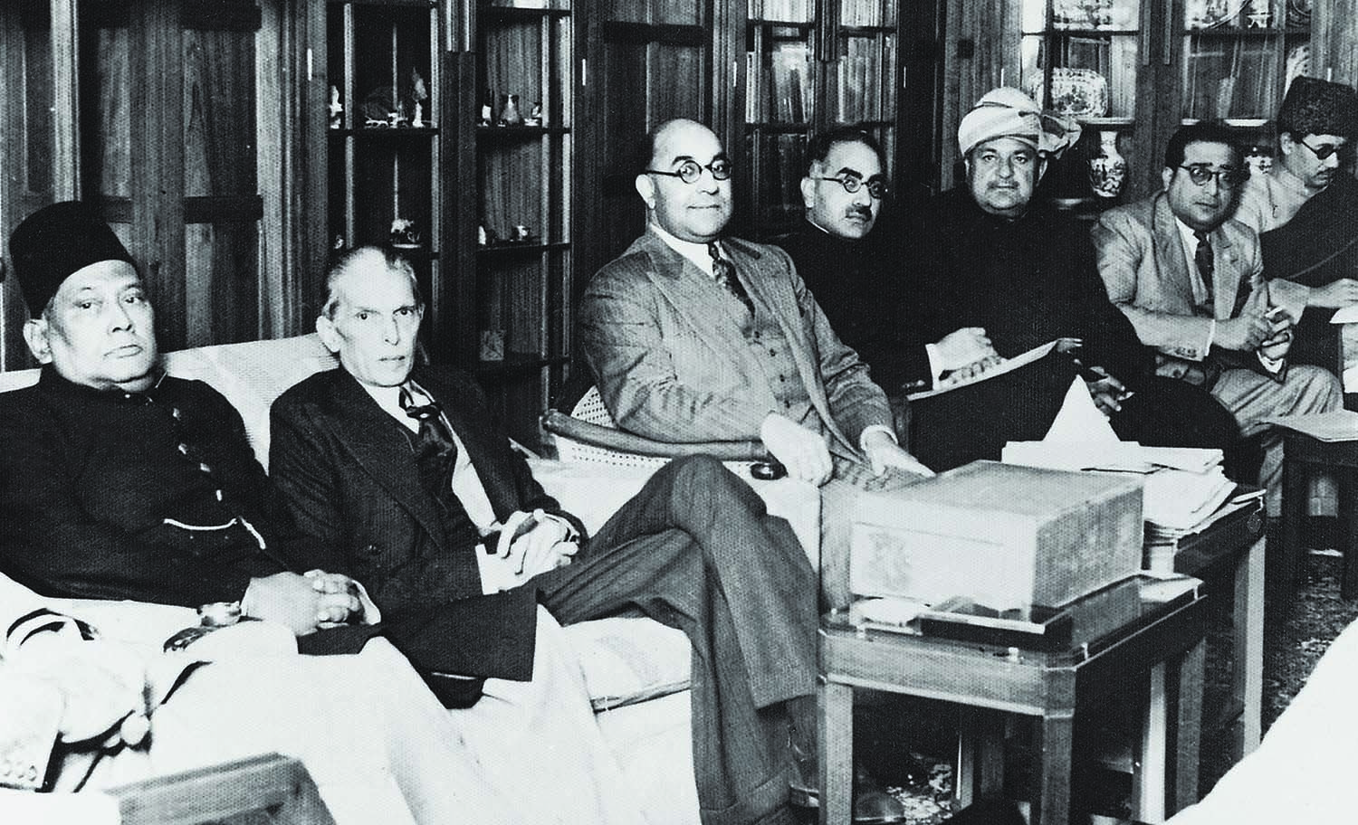 Nawabzada Liaquat Ali Khan often smiled as he faced the camera. He is seen here seated in the centre during a Muslim League Council Meeting in Bombay in the early 1940s. From extreme left are Sher-e-Bengal A.K. Fazlul Huq and Quaid-i-Azam Mohammad Ali Jinnah. On Liaquat's left are Sir Sikandar Hayat Khan, Sardar Aurangzeb Khan, and Amir Ahmed Khan, the famed Raja Sahib Mehmoodabad (extreme right). | Photo: Dawn / White Star Archives