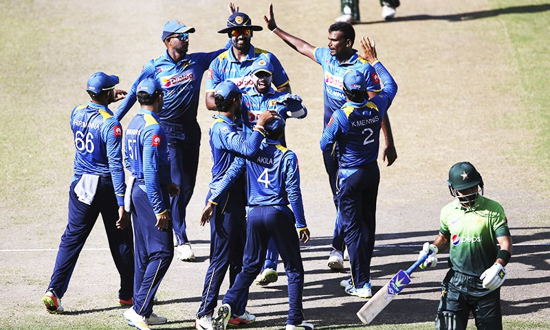 Sri Lanka players celebrate dismissal of Ahmed Shehzad. —AP