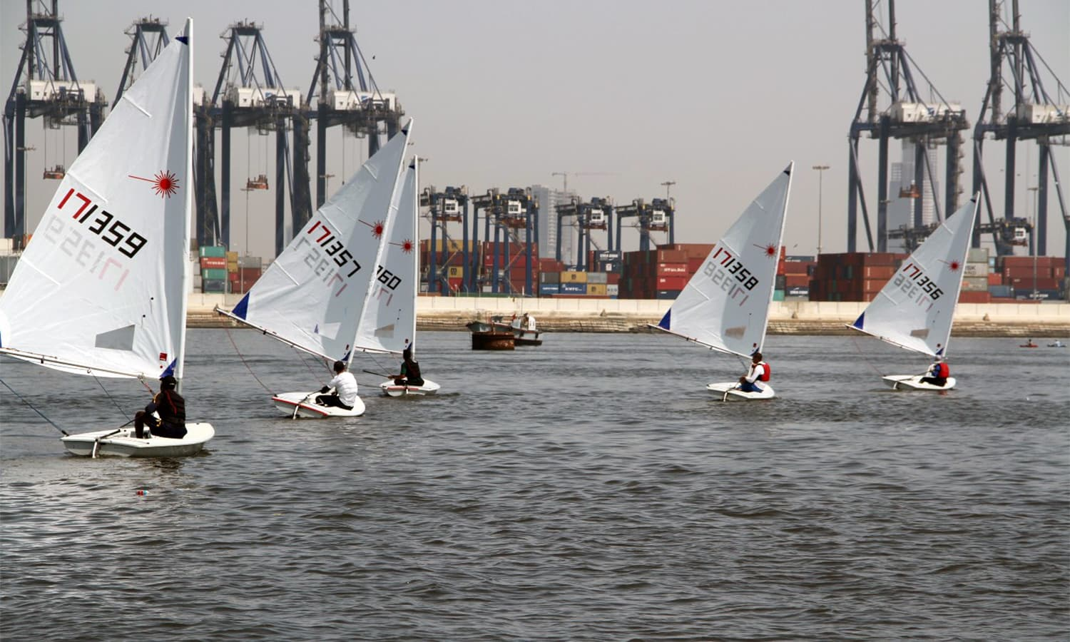 Cadets of Pakistan and other participating countries compete in the sailing race held in Karachi Harbour. —Navy PR