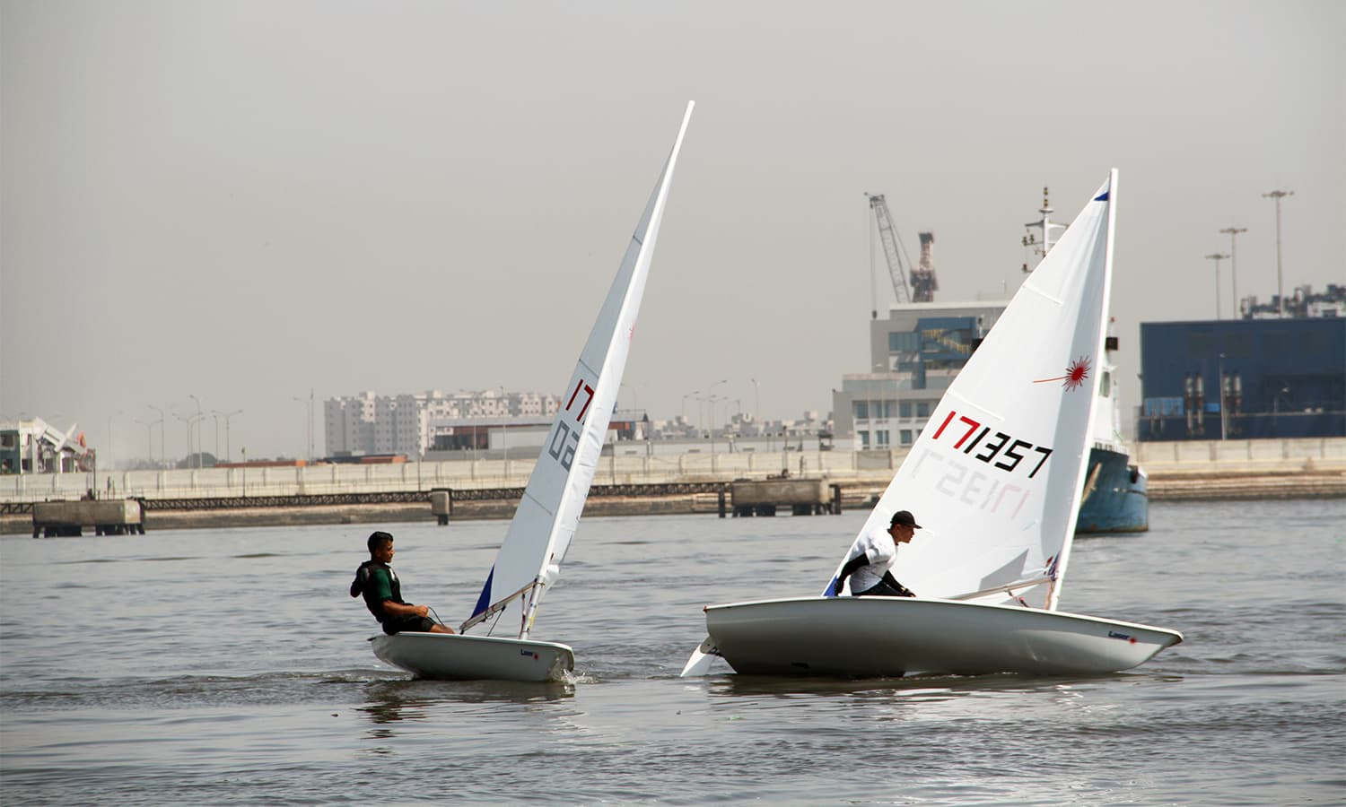 Cadets of participating countries compete in the sailing race held on the final day of the second Pak Navy's  International Nautical Competition at Karachi Harbour. — Pak Navy