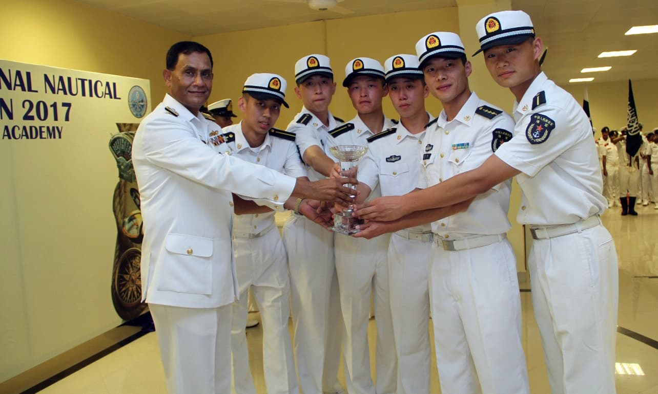 Winning team of Chinese Naval Academy receiving the trophy from Commander Karachi Rear Admiral Ather Mukhtar. —Navy PR