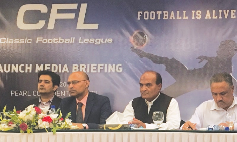 KARACHI: Shahid Khokhar (C), flanked by Haider Ali Daud Khan (second L) and Rahim Baksh Baloch, attends the launch briefing  of the Classic Football League on Friday.—Umaid Wasim