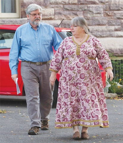Linda and Patrick Boyle, parents of Joshua Boyle, leave their home to speak to the media in Smiths Falls, Ontario.—AP