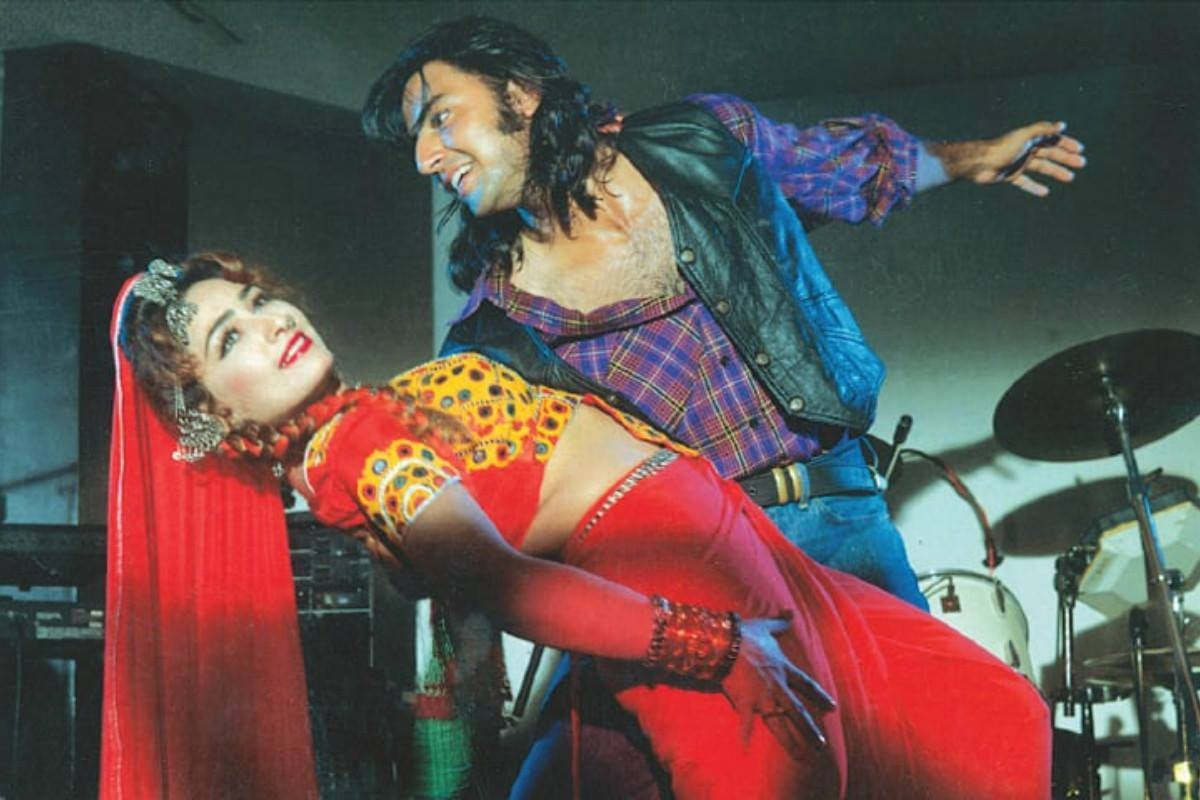 Babar Ali and Reema in Iqbal Kashmiri's 1996 fi lm Maamla Garrbarr Hai