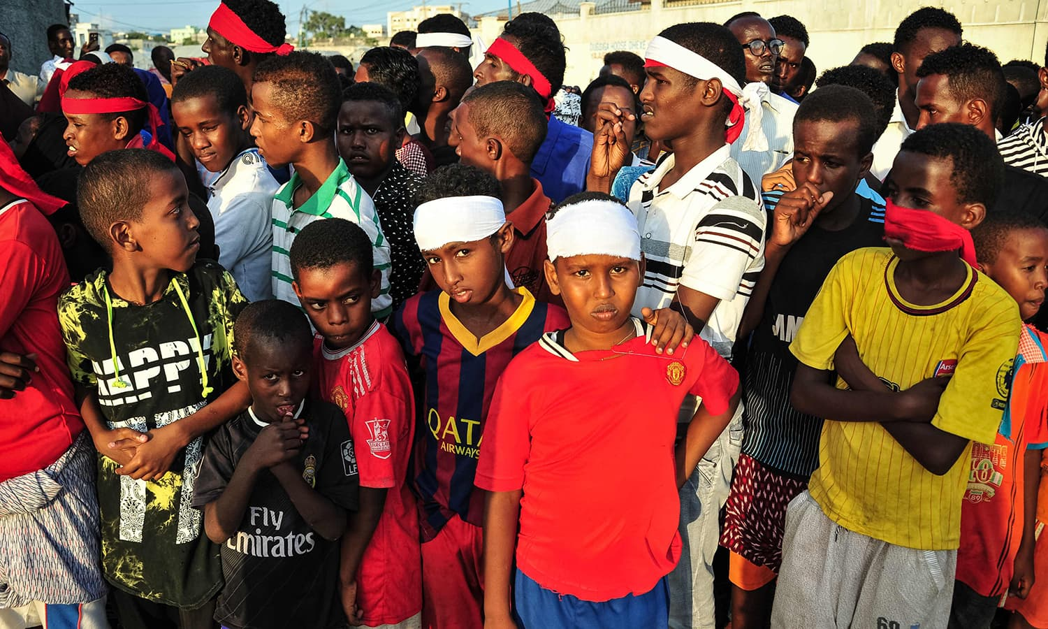 People wear headbands as a sign of anger as they protest against the deadly bomb attack in Mogadishu.─AFP
