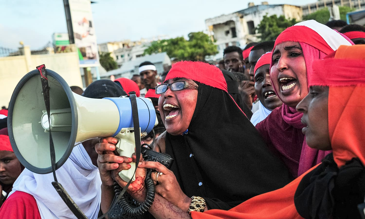 People chant slogans as they protest against the deadly bomb attack in Mogadishu.─AFP