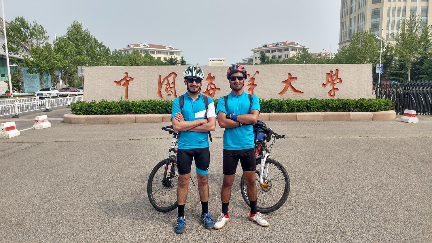 We did it! At Ocean University of China after completing our dream cycling tour.