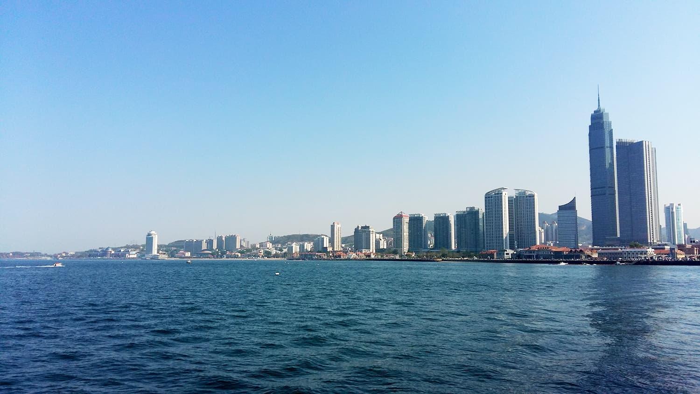 A glimpse of the Yantai business hub from the coast of Bohai Sea.