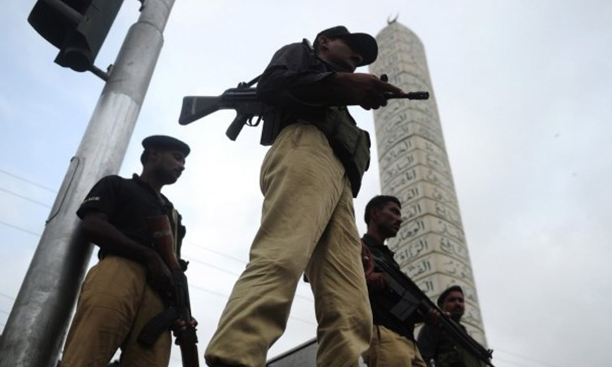 Police stand guard outside a mosque in Karachi   AFP