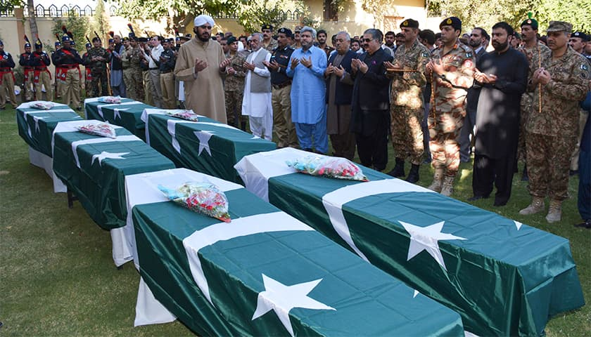Pakistani policemen and officials offer funeral prayers for policemen who died in the blast. — AFP