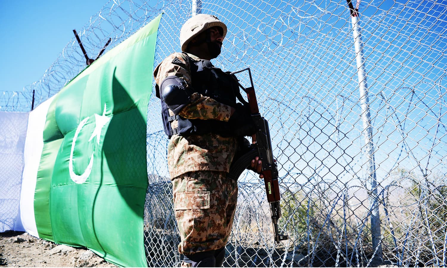 A Pakistani soldier keeps vigil next to a newly fenced border fencing in Angoor Adda, SW.—AFP