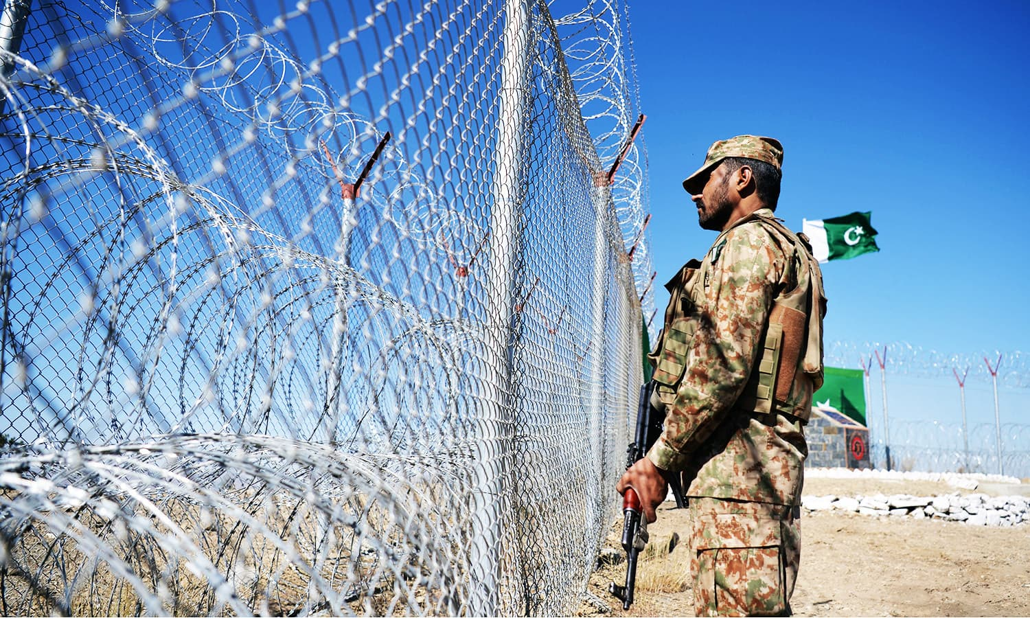 A soldier keeps vigil next to a newly fenced border fencing in Angoor Adda, South Waziristan.—AFP