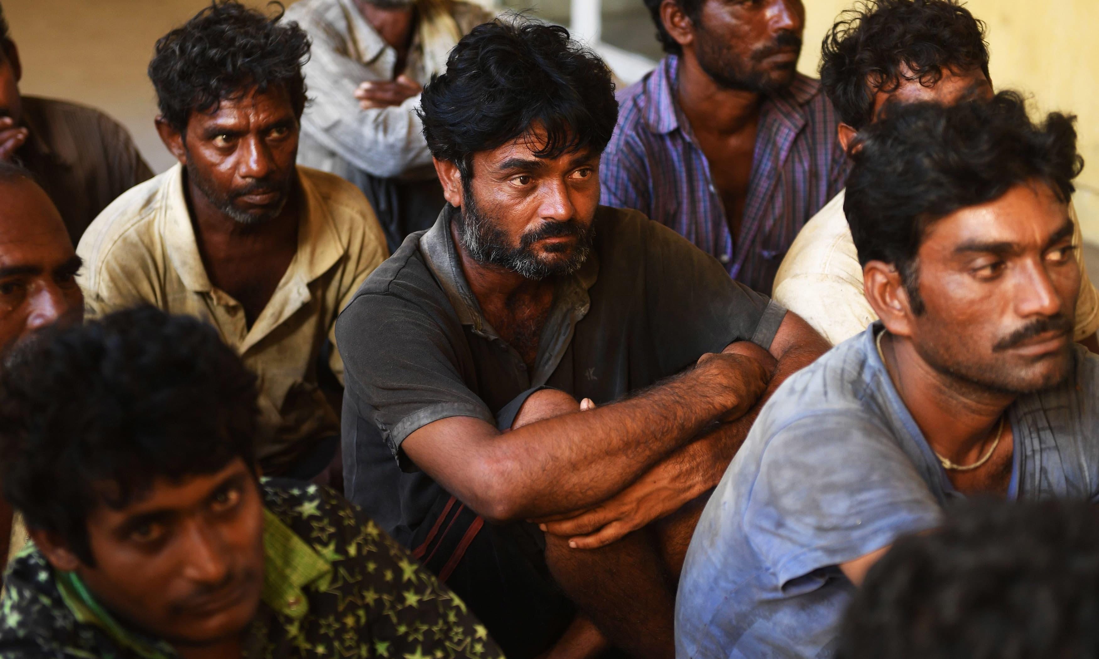 Arrested Indian fishermen sit in a police station in Karachi. —AFP