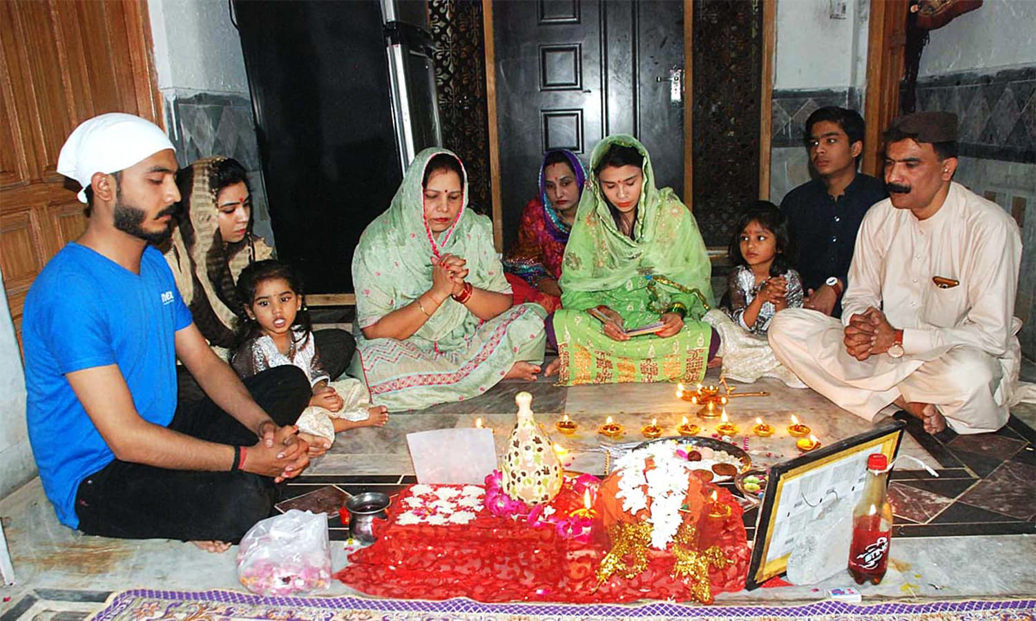 A Hindu family performs a religious ritual to celebrates Diwali at their home. ─ APP