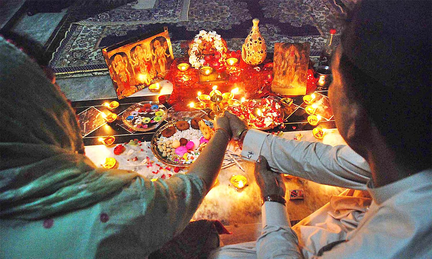 A Hindu family celebrates Diwali festival in their home. ─ APP