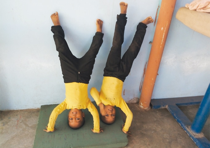 GYMNASTICS: CARTWHEELING TO HOPE