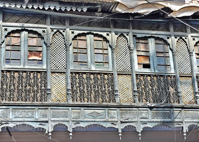 Stained glass is used to decorate jharokas, while the wood panels are carved.
