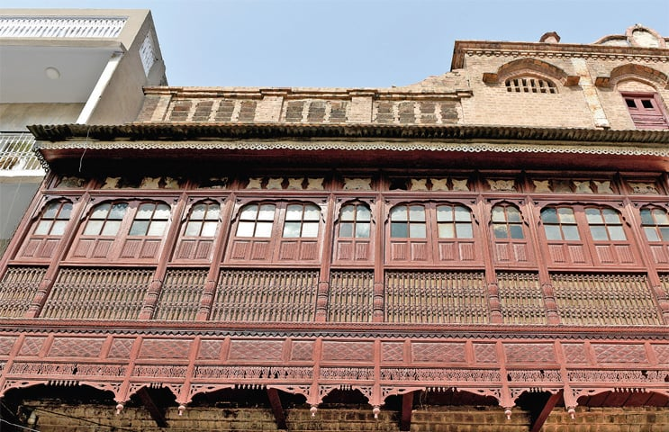 A wooden balcony in a haveli in Chittian Hattian that is said to have been built more than 150 years ago. — Photos by Tanveer Shahzad