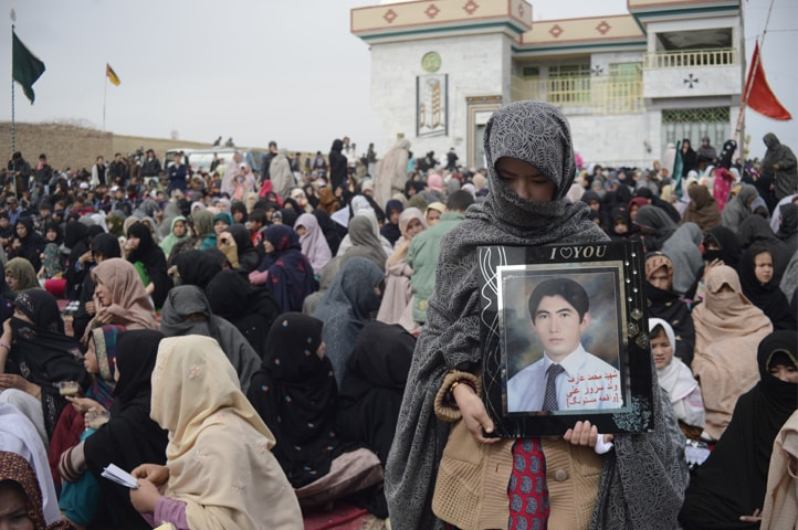A young woman grieves for Mohammad Arif who, as the photo frame suggests, was killed in Mastung | Photos by Sajjad Batoor