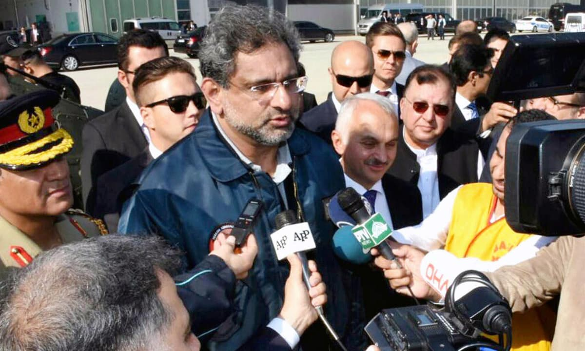 Abbasi talking to media after the test flight of Turkish T-129 helicopter. —Online