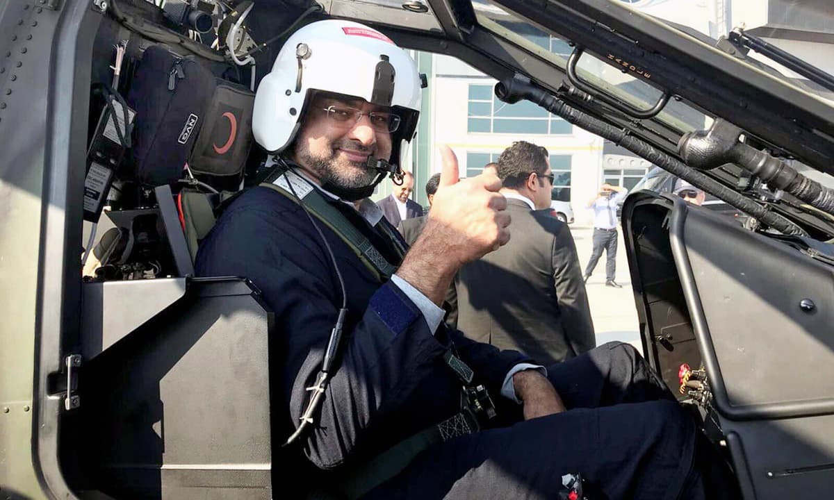 Prime Minister Shahid Khaqan Abbasi poses before the test flight of the Turkish T-129 Combat Helicopter. —Online