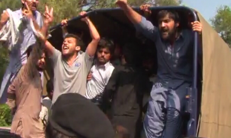 Quaid-e-Azam University students protest against administration on Monday.—DawnNews