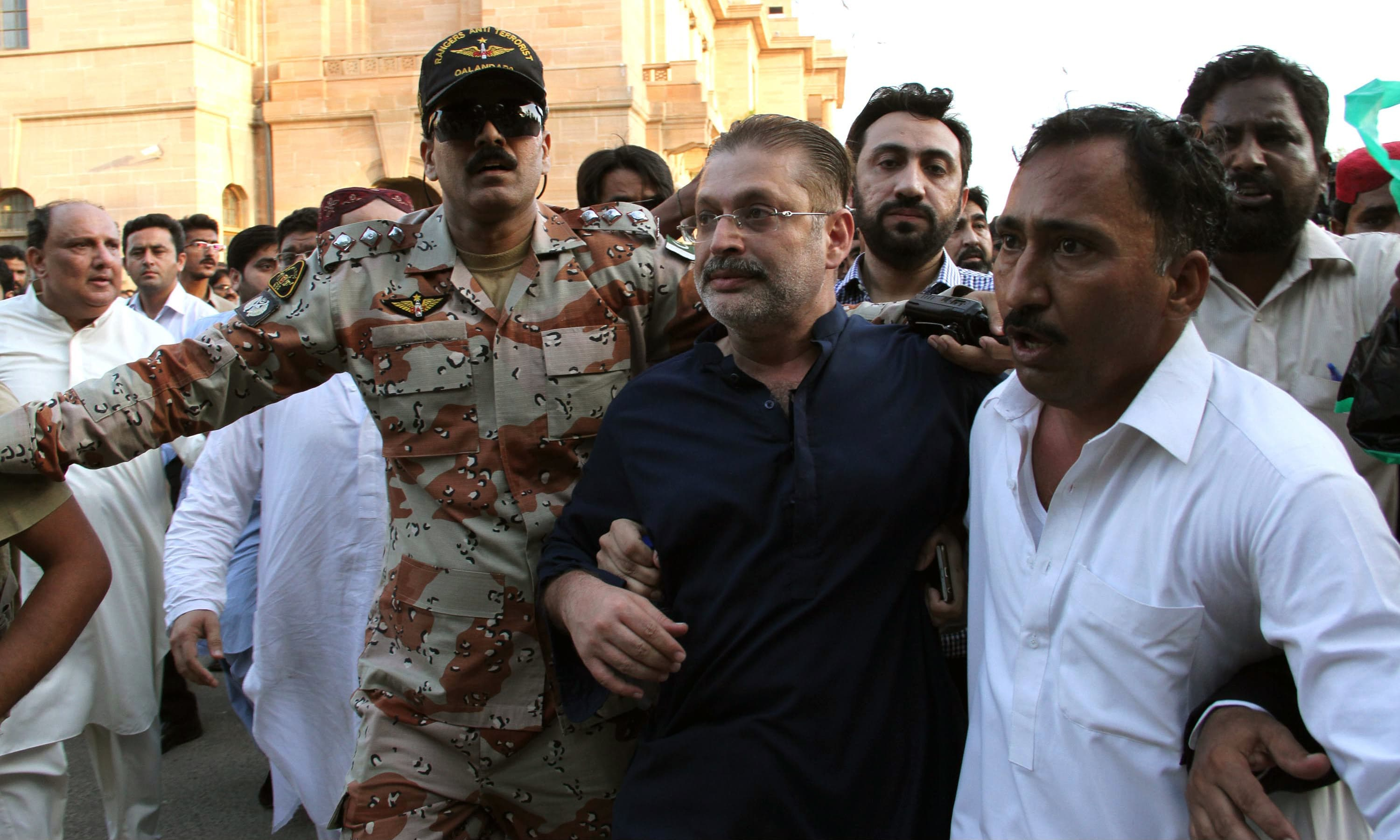 Security personnel arrest PPP leader Sharjeel Memon. —PPI
