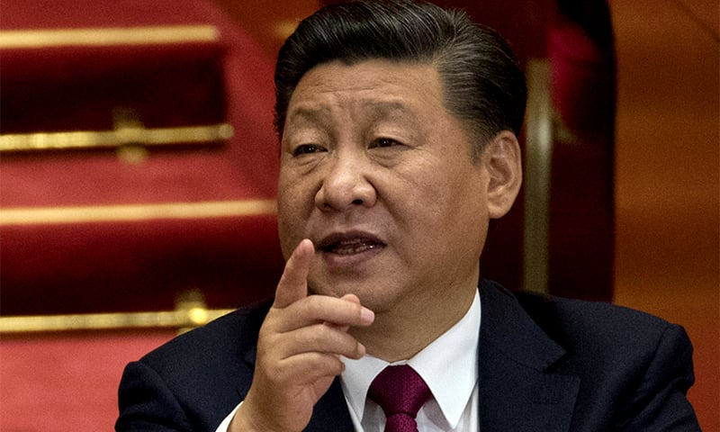 Xi tightens grip on China as Communist Party adds his name, ideology to constitution