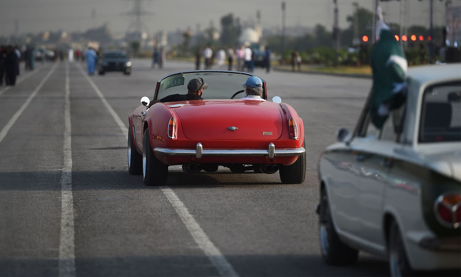 Participants of the Motor Rally drive upon arriving in Islamabad on October 23.— AFP