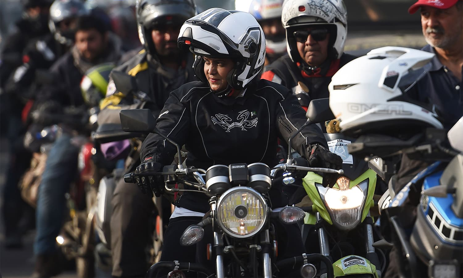 A rider participating in the Motor Rally leads bikers upon arriving in Islamabad.— AFP