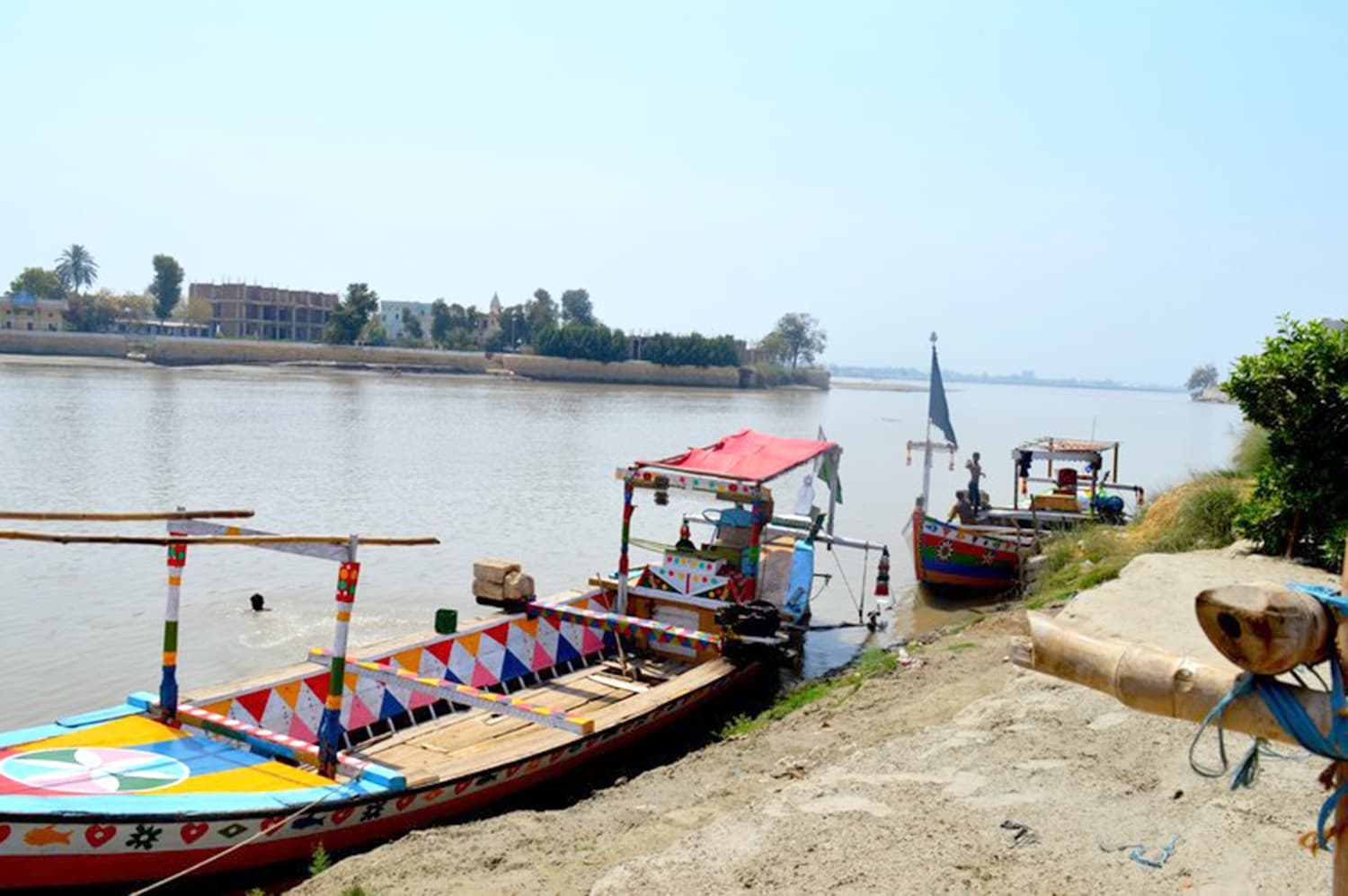 A painted boat on the shore of River Indus.
