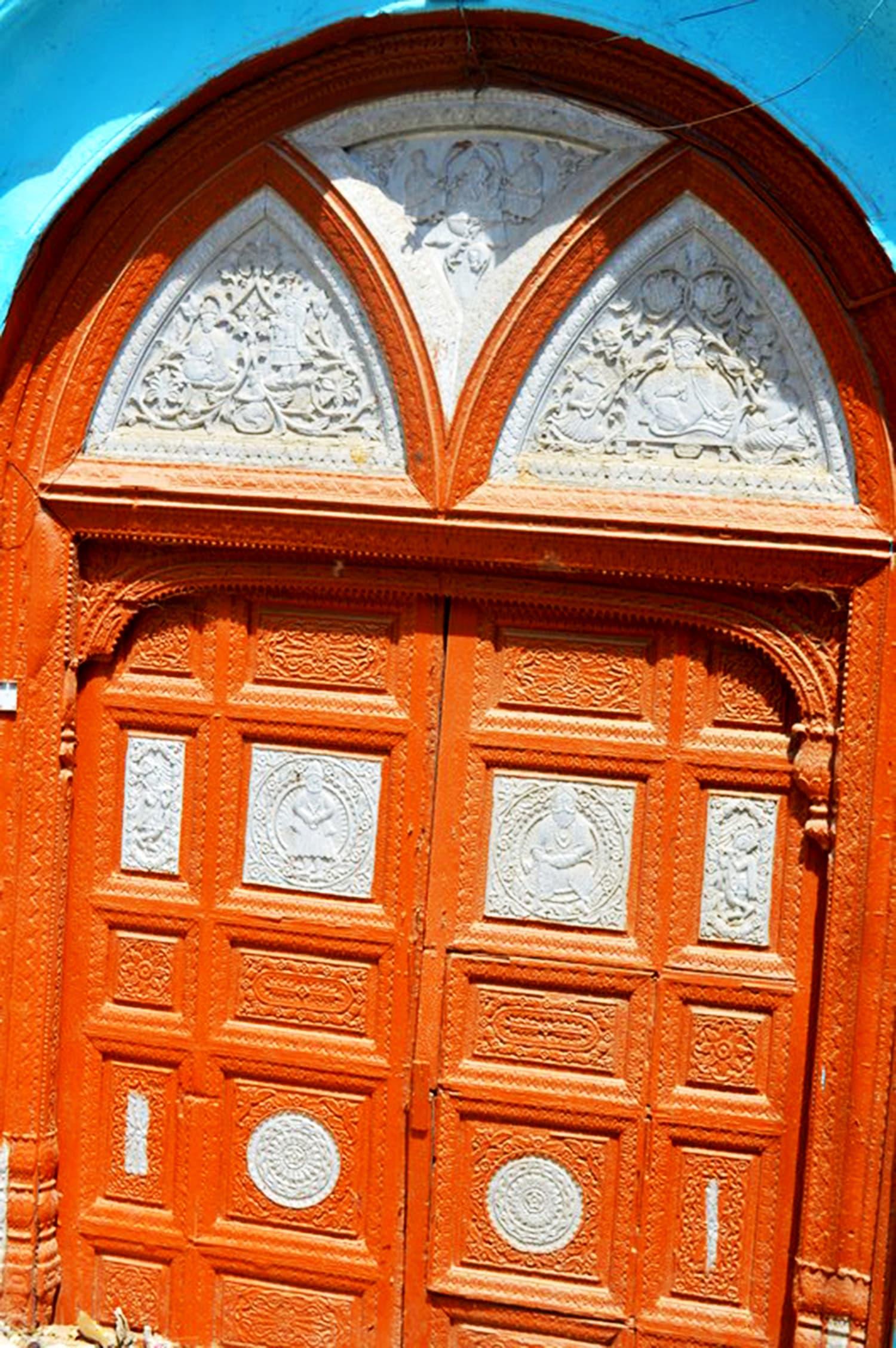An ornamental wooden door.