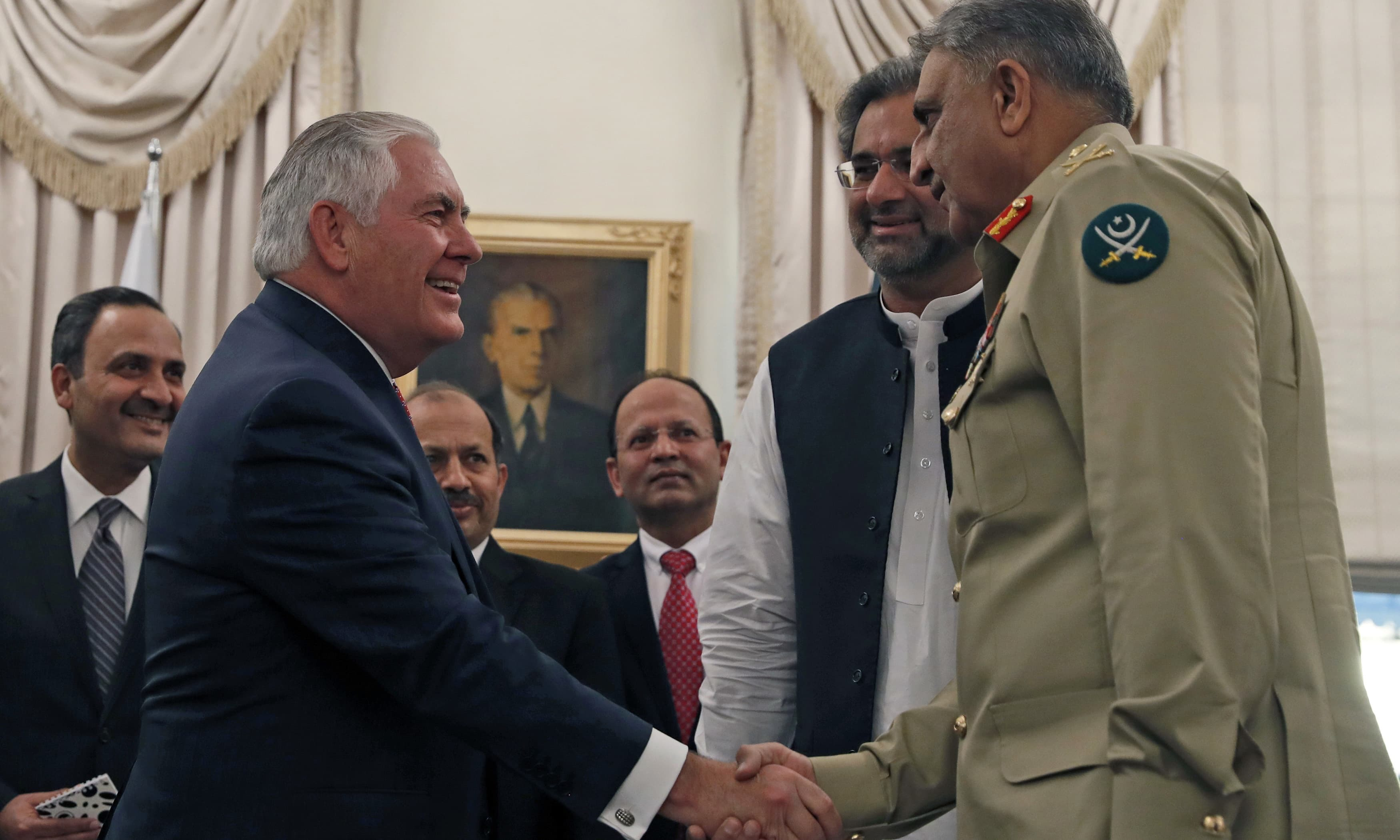 US Secretary of State Rex Tillerson shakes hands with Chief of Army Staff Qamar Javed Bajwa, with Prime Minister Shahid Khaqan Abbasi, center right, Tuesday, Oct. 24, 2017, in Islamabad, Pakistan. Photo: Associated Press